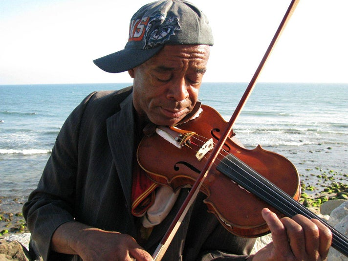 Nathaniel Ayers with a Benning violin