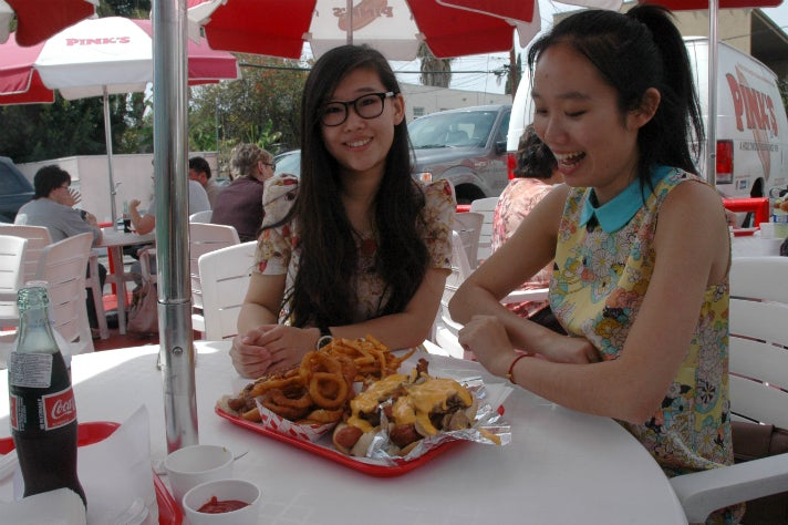 Susanna Niu and Sally Guo with their Pink's hot dogs